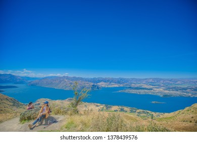 Wanaka, New Zealand, Feb 9th, 2019: tourist climb on Roys peak track, with Lake Wanaka or Lake Hawea , one of the best track in south part of New Zealand.