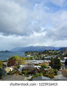Wanaka, New Zealand - October 09, 2018: View of Wanaka Town, Lake & Mountains on a stormy day in Central Otago, South Island New Zealand.