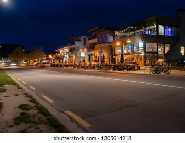 WANAKA NEW ZEALAND - OCTOBER 16; Cafes and bars line tourist town streets glowing in darkness of night October 16 2018 Wanaka New Zealand
