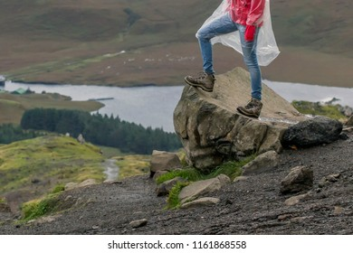 Wanderer standing on a rock at the Old Man of Storr
