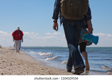 Wanderer walking at the beach