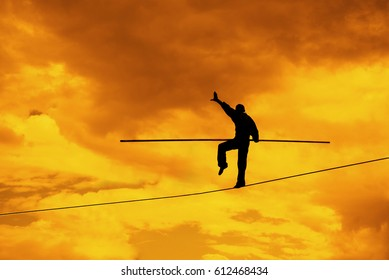 Wandering tightrope walker playing on sky background. Silhouette of Equilibrist businessman with pole on rope. idea, sign, symbol, concept of risk, peril, danger and balance in business