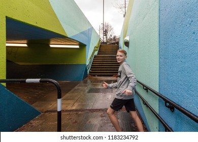 WANDSWORTH, LONDON - January 2, 2018: young man jumping on the street walls sport parkour. Wandsworth Roundabout. underground crossing. underpass, tunnel