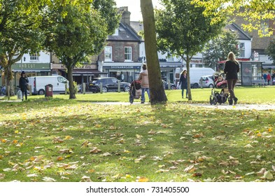 WANDSWORTH, LONDON: OCTOBER, 2017: Women pushing pushchairs on Wandsworth Common next to Bellevue Road in south west London.