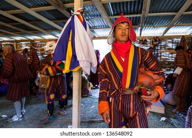 WANGDI,BHUTAN - SEPTEMBER 23:Bhutanese monk prepares backstage for traditional dance at buddhist festival on September 23,2012 in Wangdi,Bhutan.