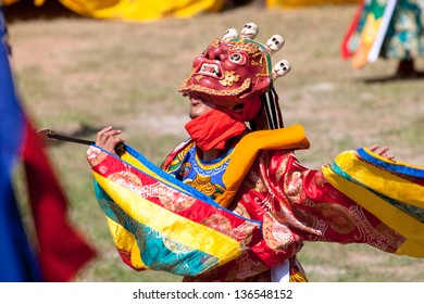 WANGDI,BHUTAN -SEPTEMBER 24: Costumed monk performs traditional dance at spectacular buddhist Festival on September 24,2012 in Wangdi,Bhutan.