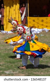 WANGDI,BHUTAN -SEPTEMBER 24: Costumed monks perform traditional dance at spectacular buddhist Festival on September 24,2012 in Wangdi,Bhutan.