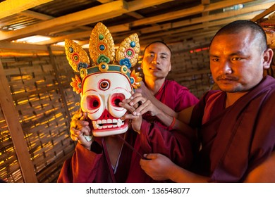 WANGDI,BHUTAN - SEPTEMBER 24:Bhutanese monks prepare backstage for traditional dance at buddhist festival on September 24,2012 in Wangdi,Bhutan.
