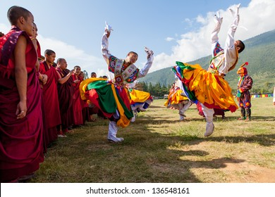 WANGDI,BHUTAN - SEPTEMBER 24:Monks prepare  for traditional dance at buddhist festival on September 24,2012 in Wangdi,Bhutan.The festival is in honor of Guru Rinpoche who brought Buddhism to Bhutan.