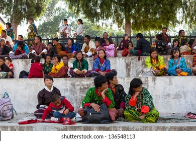 WANGDI,BHUTAN - SEPTEMBER 24:Spectators in traditional dress watch festivities on the yearly buddhist festival on September 24,2012 in Wangdi,Bhutan.
