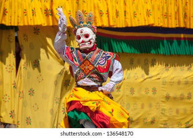 WANGDI,BHUTAN -SEPTEMBER 25: Costumed monk performs traditional dance at spectacular buddhist Festival on September 25,2012 in Wangdi,Bhutan.