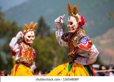 WANGDI,BHUTAN -SEPTEMBER 25: Costumed monks perform traditional dance at spectacular buddhist Festival on September 25,2012 in Wangdi,Bhutan.