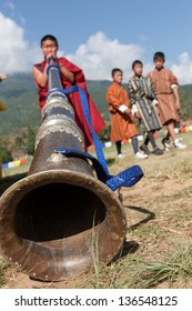 WANGDI,BHUTAN - SEPTEMBER 25:Monk plays traditional himalayan horn at buddhist festival on September 25,2012 in Wangdi,Bhutan.The festival is in honor of Guru Rinpoche who brought Buddhism to Bhutan.