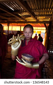 WANGDI,BHUTAN - SEPTEMBER 25:Monk shows copper gloves at buddhist festival on September 25,2012 in Wangdi,Bhutan.The gloves are used in traditional dances at the Wangdi festival.