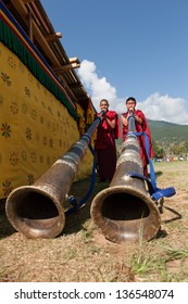 WANGDI,BHUTAN - SEPTEMBER 25:Monks play traditional himalayan horn at buddhist festival on September 25,2012 in Wangdi,Bhutan.The festival is in honor of Guru Rinpoche who brought Buddhism to Bhutan.