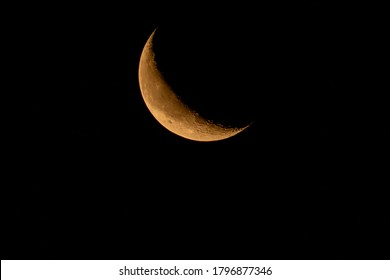 Waning crescent moon rising in the early dawn. Oregon, Ashland, Cascade Siskiyou National Monument, Summer