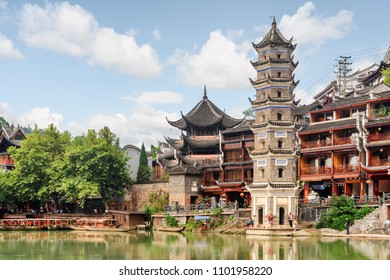 The Wanming Pagoda by the Tuojiang River (Tuo Jiang River) in Phoenix Ancient Town (Fenghuang County), China. Fenghuang is a popular tourist destination of Asia.