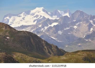 Wannerhorn (left), Grunhorn (centre) and Fiescherhorner (right) in the Bernese Alps viewed from the Nufenen Pass