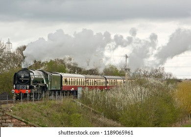 WANSFORD, CAMBRIDGESHIRE, UK - APRIL 7, 2012: LNER Class A1 Peppercorn 4-6-2  60163 'Tornado' approaches Wansford with the 2M26 11:09 service out of Peterborough Nene Valley, during the Easter gala.