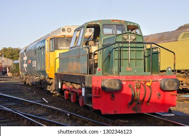 WANSFORD, CAMBRIDGESHIRE, UK - SEPTEMBER 29, 2012: Rolls-Royce powered DH Sentinel 0-6-0 industrial shunter No. DL83 (10271/1967) moves Class 50 No. 50026 'Indomitable' ready for the NVR's Diesel Gala