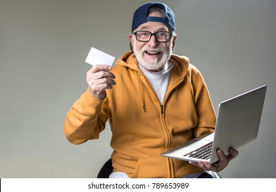 1bf283618cc1 I want to spend pension. Waist up portrait of cheerful old man sitting on  chair