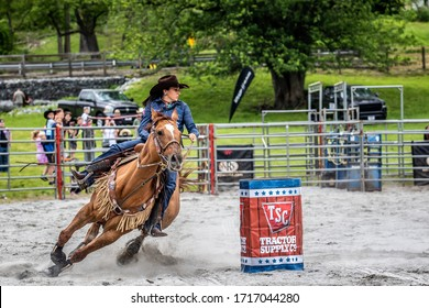 Wantage, NJ USA May 25,2019 Female Barrel Racer Making the Turn Around the Barrel at Green Valley Farms