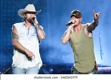 "WANTAGH, NY - JUL 20: Brian Kelley, (L) and Tyler Hubbard of Florida Georgia Line perform during the ""Can't Say I Ain't Country"" Tour on July 20, 2019 at Northwell Health at Jones Beach Theater."
