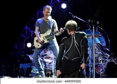 WANTAGH, NY-AUG 14: David Lee Roth (R) and Eddie Van Halen of Van Halen perform onstage at Jones Beach Theater on August 14, 2015 in Wantagh, New York.