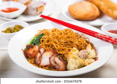 wantan noodles on wooden table