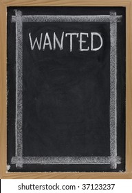 wanted sign handwritten with white chalk on blackboard with copy space below