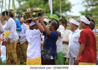 Wapejaya Village, Tiworo Tengah Subdistrict, West Muna, Indonesia - March 11, 2021: Photo of Blur and Noise Traditional Water Purification Ceremony named Melasti before celebrating silence day Nyepi