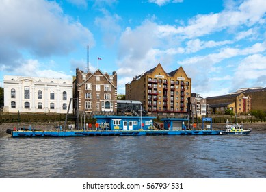 WAPPING, LONDON, UK - 18OCT2016: Wapping Police Pontoon and Station is the HQ and operating base of the Metropolitan Police Marine Policing Unit covering the River Thames.