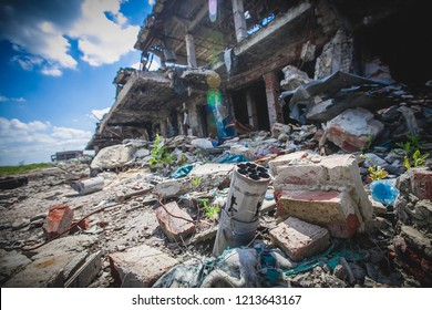 War actions aftermath, rocket artillery Grad the rest of munition near building's ruins, Ukraine and Donbass conflict, former Airport area near city of Donetsk