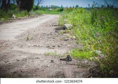 War actions aftermath, Ukraine and Donbass conflict, part of mortar shell lies on the roadside, former Airport area near city of Donetsk
