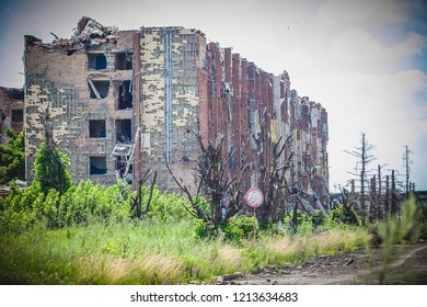War actions aftermath, Ukraine and Donbass conflict, shelled house and damaged trees, former Airport area near city of Donetsk