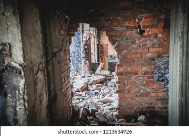 War actions aftermath, Ukraine and Donbass conflict, hole in the half-ruined wall in former Airport near city of Donetsk
