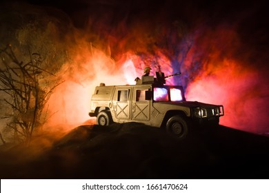 War Concept. Battle scene on war fog sky background, Fighting silhouettes Below Cloudy Skyline at night. Army vehicle with soldiers artwork decoration. Selective focus
