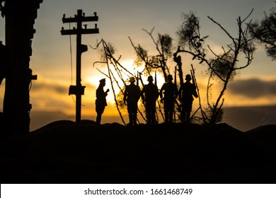 War Concept. Military silhouettes fighting scene on war fog sky background, World War Soldiers Silhouette Below Cloudy Skyline At sunset. Battle in ruined city. Selective focus