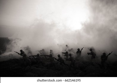 War Concept. Military silhouettes fighting scene on war fog sky background, World War Soldiers Silhouettes Below Cloudy Skyline At night. Attack scene. Armored vehicles. Tanks battle. Decoration