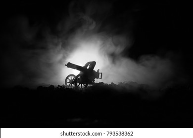 War Concept. Military silhouettes fighting scene on war fog sky background, World War Soldiers Silhouettes Below Cloudy Skyline At night. Attack scene. Vintage machine gun and soldiers during battle