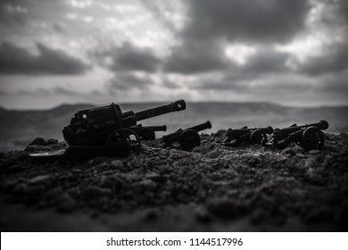 War Concept. Old artillery cannon guns on war fog sky background. Selective focus