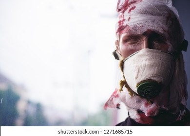 War is a crime against humanity. Dummy man wear gas mask against chemical attack. War victim dummy casualty. Dummy of war soldier. Victim of armed conflict. Badly wounded and injured, copy space.