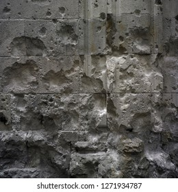 War damage. Shrapnel marks against ancient wall. Remains of Spanish Civil war at Barcelona city.