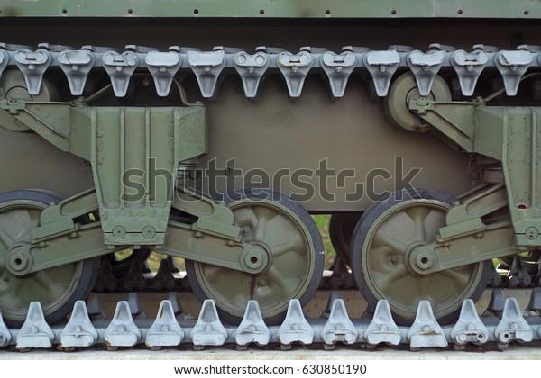war machine tank wheels closeup metal military equipment vehicle