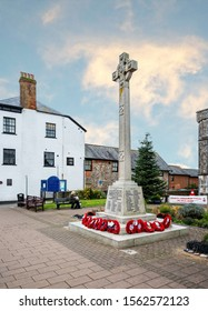 War memorial cross with poppies for remembrance sunday in Honiton, Devon, UK on 14 November 2019