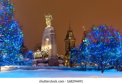 War memorial under the snow in downtown Ottawa at night