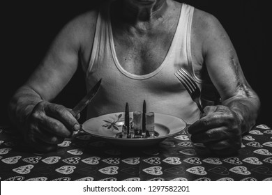 war soldier invalid sitting on the table with fork, knife and plate full of ammunition