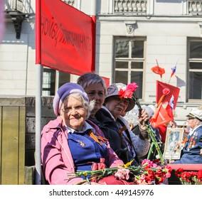 """War veterans in action """"Immortal regiment."""" St. Petersburg, Russia - 9 May, 2016. Memory Action """"Immortal regiment"""" in St. Petersburg."""