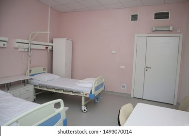 The ward in the hospital.  Bed, wardrobe, nightstand.
