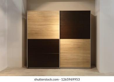 Wardrobe Closet With Square Wooden Doors in Bedroom